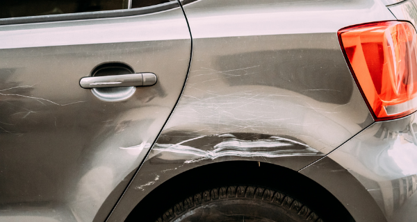 Dented and scratched vehicle of a senior who is now having difficulties with driving.