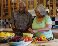 senior couple in kitchen preparing a healthy meal together