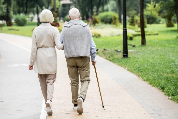 Senior man and woman take walk together