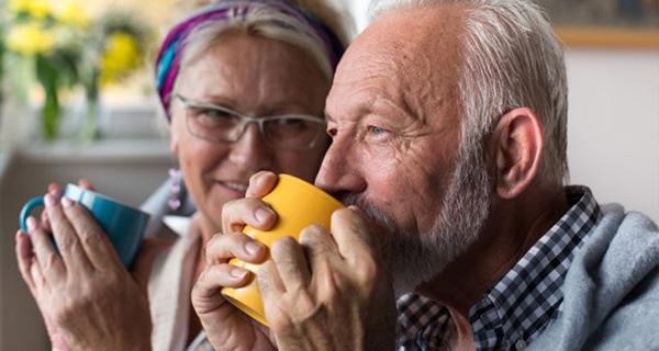 senior couple enjoying a hot drink together