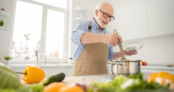 Senior man swapping food for healthier food choices