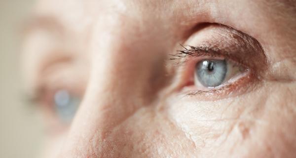 Close up of a senior's blue eyes.