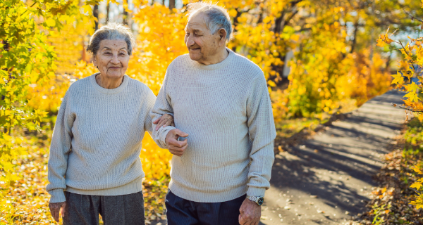 Caregiver and senior loved one take a walk in Central Park