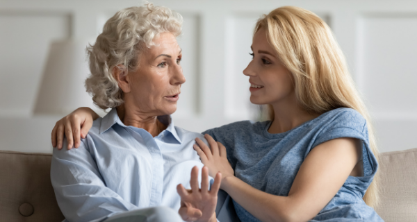 Adult daughter talking to her mother about assisted living.