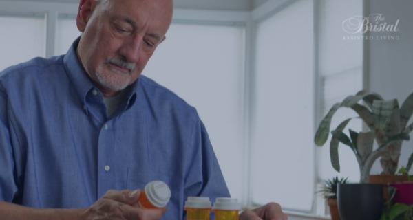 Senior adult looking at pill bottles