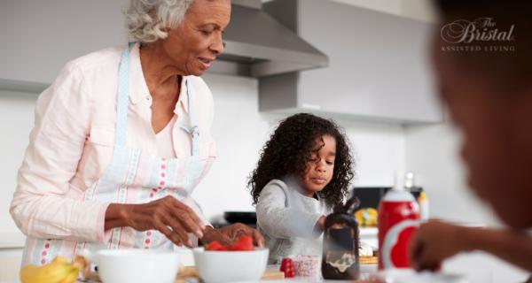 Grandmother and granddaughter baking together.