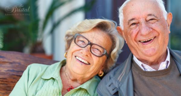 Happy senior couple sitting together