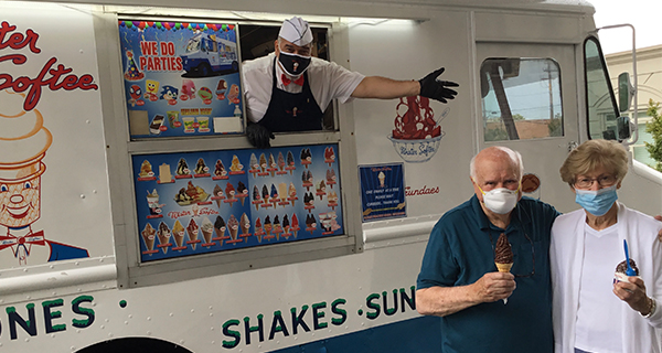 A resident gets an ice cream cone from Mr. Softee