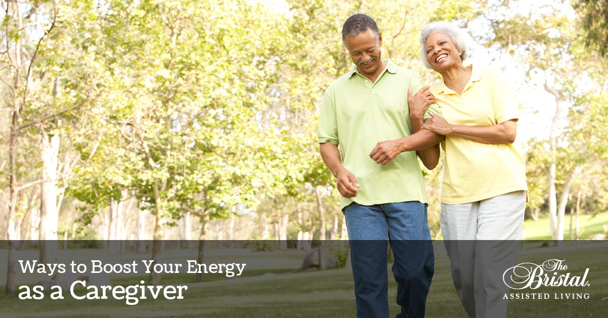 Ways to Boost Your Energy as a Caregiver, Senior Couple Walking In Park laughing together, the Bristal logo