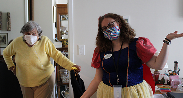 Staff member and resident on Disney day