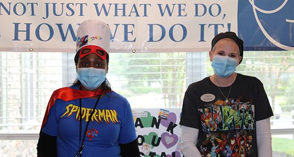 Staff pose on superhero day