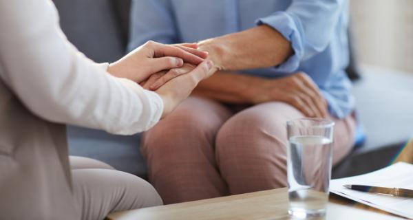 Social worker comforting female caregiver