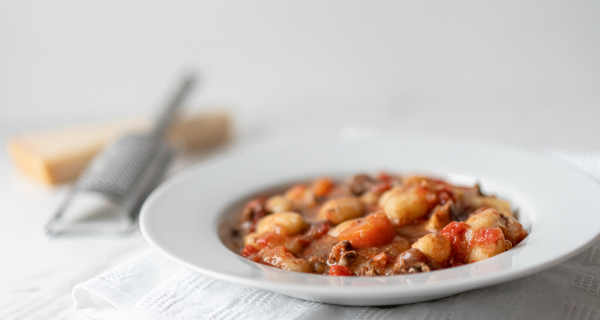 Bowl of sweet potato gnocchi with turkey bologese