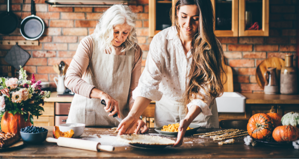 Senior woman and young woman cooking fall recipes in the kitchen