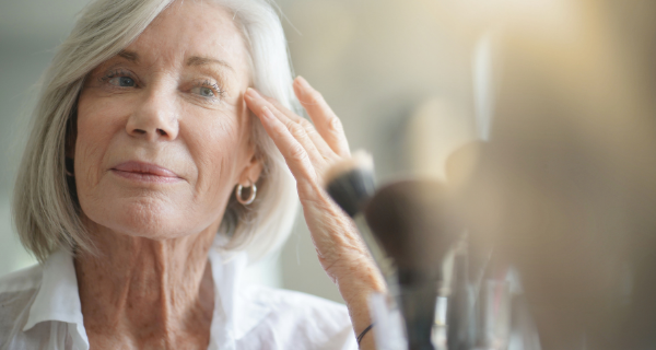 Senior woman following DIY skin care routine