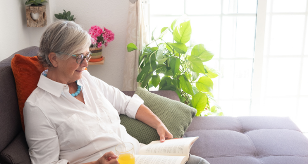 Senior woman relaxes with book to reduce stress